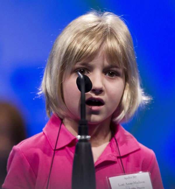 Six year-old Lori Ann Madison, of Woodbridge, Va., the youngest contestant in the history of the National Spelling Bee, spells her word during the second round on Wednesday, May 30, 2012 in Oxon Hill, Md.  &#40;AP Photo&#47;Evan Vucci&#41; <span class=meta>(AP Photo&#47; Evan Vucci)</span>