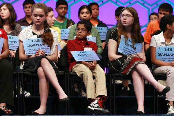 From left, Jordan Hoffman, 14, of Lee&#39;s Summit, Mo., Gokul Venkatachalam, 11, of Chesterfield, Mo., and Emma Ciereszynski, 14, of Dover, N.H., wait for their turn to spell in the semifinals of the National Spelling Bee, Thursday, May 31, 2012, in Oxon Hill, Md.  &#40;AP Photo&#47;Jacquelyn Martin&#41; <span class=meta>(AP Photo&#47; Jacquelyn Martin)</span>