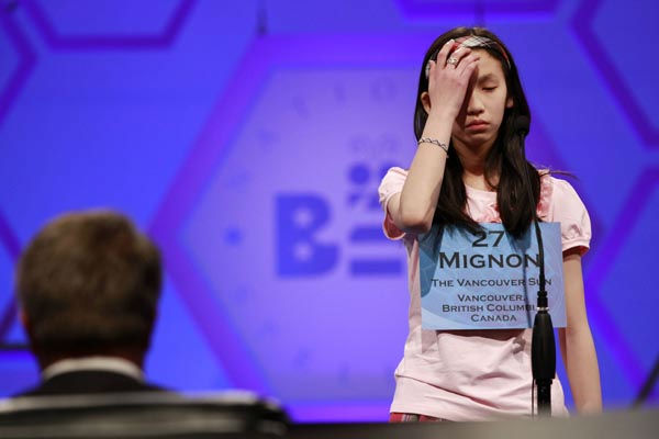 Mignon Tsai, 12, of Abbotsford, British Columbia, Canada, reacts  as she misspells a word during round five of the semifinals at the National Spelling Bee in Oxon Hill, Md., Thursday, May 31, 2012.  &#40;AP Photo&#47;Jacquelyn Martin&#41; <span class=meta>(AP Photo&#47; Jacquelyn Martin)</span>