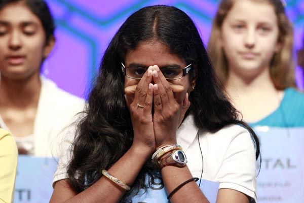 SPECIAL FOR SAN DIEGO TRIBUNE - Snigdha Nandipate, 14, of San Diego, listens to fellow spellers during the semifinals of the National Spelling Bee in Oxon Hill, Md., on Thursday, May 31, 2012.  &#40;AP Photo&#47;Jacquelyn Martin&#41; <span class=meta>(AP Photo&#47; Jacquelyn Martin)</span>