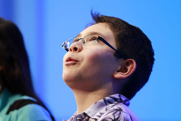 Jae Canetti, 10, of Fairfax, Va., breathes a sigh of relief at his seat after spelling a word correctly during the fourth round of the semifinals at the National Spelling Bee in Oxon Hill, Md., Thursday, May 31, 2012.  &#40;AP Photo&#47;Jacquelyn Martin&#41; <span class=meta>(AP Photo&#47; Jacquelyn Martin)</span>