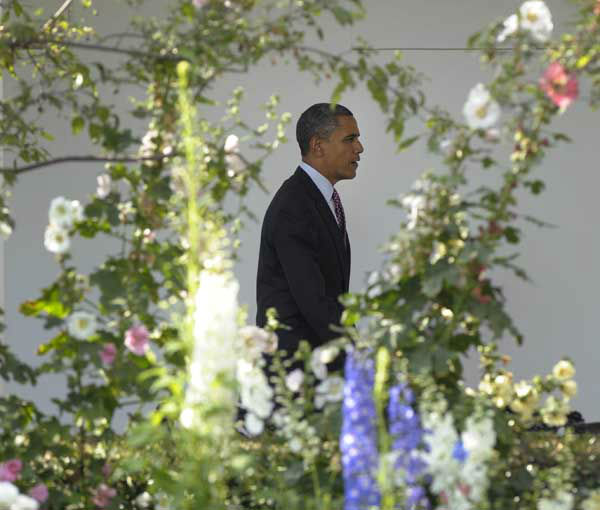 "<div class=""meta ""><span class=""caption-text "">President Barack Obama walks along the Colonnade at the White House in Washington, Friday, June 15, 2012, before heading to Chicago for the weekend with his family. (AP Photo/Susan Walsh) (Photo/Susan Walsh)</span></div>"