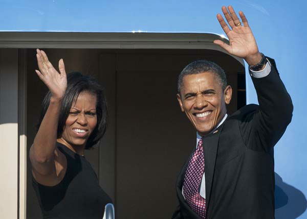 President Barack Obama and first lady Michelle Obama wave as they board Air Force One at Andrews Air Force Base, Md., Friday, June 15, 2012. They are going to Chicago for the weekend. &#40;AP Photo&#47;Cliff Owen&#41; <span class=meta>(AP Photo&#47; Cliff Owen)</span>