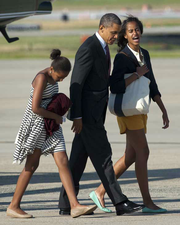 President Barack Obama heads to Air Force One with his daughters Sasha, left, and Malia at Andrews Air Force Base, Md., Friday, June 15, 2012. The first family is going to Chicago for the weekend. &#40;AP Photo&#47;Cliff Owen&#41; <span class=meta>(AP Photo&#47; Cliff Owen)</span>