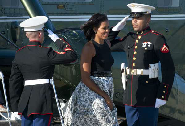"<div class=""meta ""><span class=""caption-text "">Marine Corps security officers salute as first lady Michelle Obama exits Marine One at Andrews Air Force Base, Md., Friday, June 15, 2012, to board Air force One en route to Chicago for a weekend with family. (AP Photo/Cliff Owen) (AP Photo/ Cliff Owen)</span></div>"