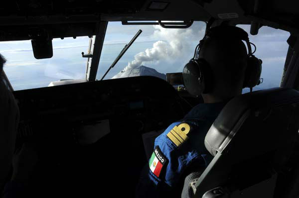 In this image released by the Mexican Navy &#40;SEMAR&#41;, seen from the cockpit of an aircraft, steam and ash rise from the crater of the Popocatepetl volcano on the outskirts of Mexico City as pilots approach the volcano on Wednesday, July 10, 2013. Last Saturday, Mexico&#39;s National Center for Disaster Prevention raised the volcano alert from Stage 2 Yellow to Stage 3 Yellow, the final step before a Red alert, when possible evacuations could be ordered after the Popocatepetl volcano spit out a cloud of ash and vapor 2 miles &#40;3 kilometers&#41; high over several days of eruptions. &#40;AP Photo&#47;SEMAR&#41; <span class=meta>(AP Photo&#47; DLM LM**MEX**)</span>