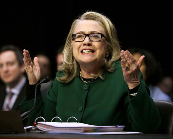 Secretary of State Hillary Rodham Clinton reacts to a question as she testifies on Capitol Hill in Washington, Wednesday, Jan. 23, 2013, before the Senate Foreign Relations Committee hearing on the deadly September attack on the U.S. diplomatic mission in Benghazi, Libya, that killed Ambassador Chris Stevens and three other Americans.  &#40;AP Photo&#47;Pablo Martinez Monsivais&#41; <span class=meta>(AP Photo&#47; Pablo Martinez Monsivais)</span>