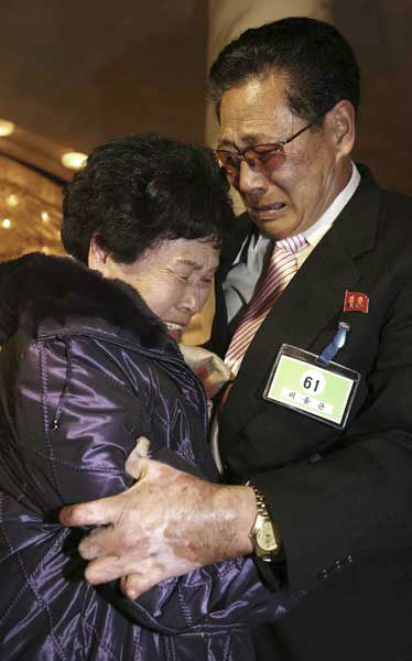 South Korean Lee Son-hyang, 88, left, and her North Korean brother Lee Yoon Geun ,72, get emotional as they reunite during the Separated Family Reunion Meeting at Diamond Mountain resort in North Korea, Thursday, Feb. 20, 2014. The rival nations struck a deal last week to go ahead with brief meetings of war-divided families, though there&#39;s wariness in Seoul that Pyongyang could back out again. As they waited anxiously in the days leading up to the trip, many elderly Koreans had been unsure whether they would be able to see their long-lost relatives&#39; faces before they die. &#40;AP Photo&#47;Yonhap, Lee Ji-eun&#41;  KOREA OUT <span class=meta>(Photo&#47;Lee Ji-eun)</span>