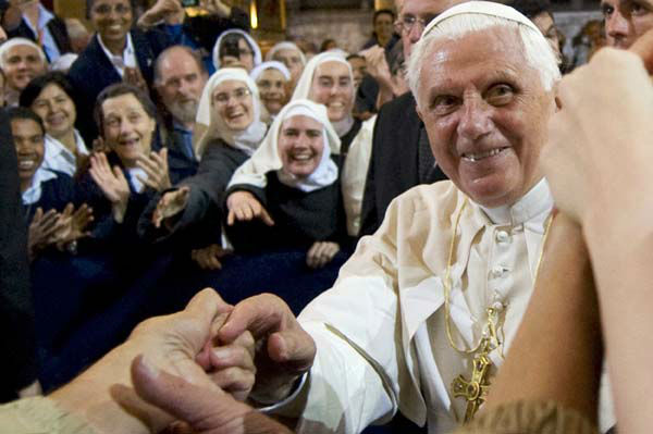 "<div class=""meta image-caption""><div class=""origin-logo origin-image ""><span></span></div><span class=""caption-text"">FILE - In this Friday, Sept. 12, 2008 file photo, Pope Benedict XVI waves to wellwishers as he leaves the Notre-Dame cathedral in Paris, following a vespers service. Pope Benedict XVI announced Monday, Feb. 11, 2013, he would resign Feb. 28 because he is simply too old to carry on. (AP Photo/Philippe Wojazer, Pool, File) (AP Photo/ Philippe Wojazer)</span></div>"