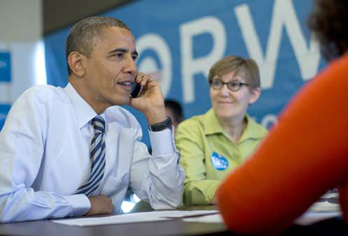 President Barack Obama calls to thank volunteers in Wisconsin, at campaign office call center the morning of the 2012 election, Tuesday, Nov. 6, 2012, in Chicago. Carla Windhorst is seated next to the president. &#40;AP Photo&#47;Carolyn Kaster&#41; <span class=meta>(AP Photo&#47; Carolyn Kaster)</span>