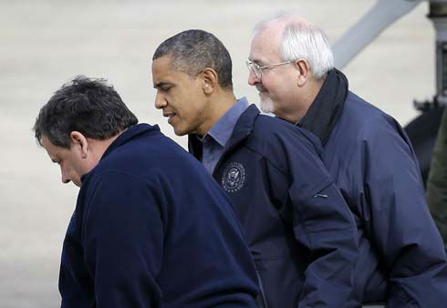 "<div class=""meta ""><span class=""caption-text "">President Barack Obama, flanked by Federal Emergency Management Agency (FEMA) administrator Craig Fugate, right, and New Jersey Gov. Chris Christie, left, walks on the tarmac at Atlantic City International Airport, Wednesday, Oct. 31, 2012, in Atlantic City, NJ. Obama traveled to region to take an aerial tour of the Atlantic Coast in New Jersey in areas damaged by superstorm Sandy,   (AP Photo/ Patrick Semansky)</span></div>"