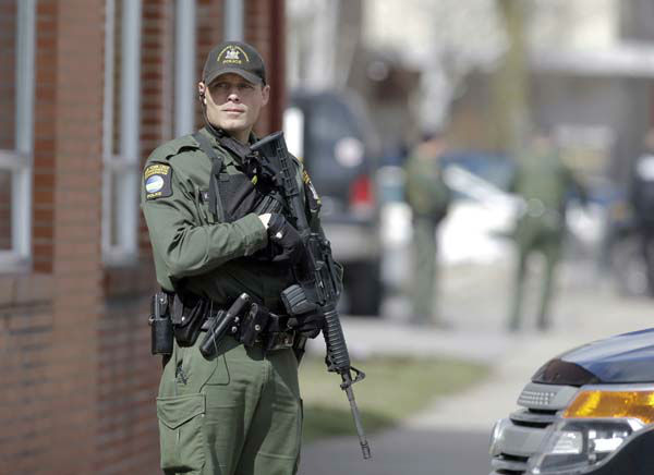 A law enforcement officer stands on Main Street in Herkimer, N.Y., during the search for a suspect in two shootings that killed four and injured at least  two on, Wednesday, March 13, 2013. Authorities were looking for 64-year-old Kurt Meyers, said Herkimer Police Chief Joseph Malone. Officials say guns and ammunition were found inside his Mohawk apartment after emergency crews were sent to a fire there Wednesday morning.  &#40;AP Photo&#47;Mike Groll&#41; <span class=meta>(AP Photo&#47; Mike Groll)</span>