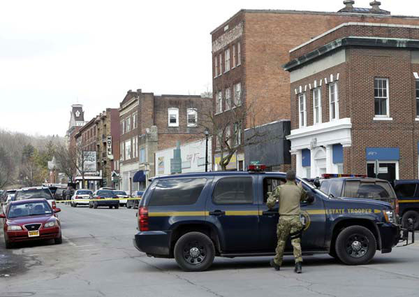 Law enforcement officers block off Main Street  in Herkimer, N.Y., while searching for a suspect in two shootings that killed four and injured at least  two on, Wednesday, March 13, 2013. Authorities were looking for 64-year-old Kurt Meyers, said Herkimer Police Chief Joseph Malone. Officials say guns and ammunition were found inside his Mohawk apartment after emergency crews were sent to a fire there Wednesday morning.  &#40;AP Photo&#47;Mike Groll&#41; <span class=meta>(AP Photo&#47; Mike Groll)</span>