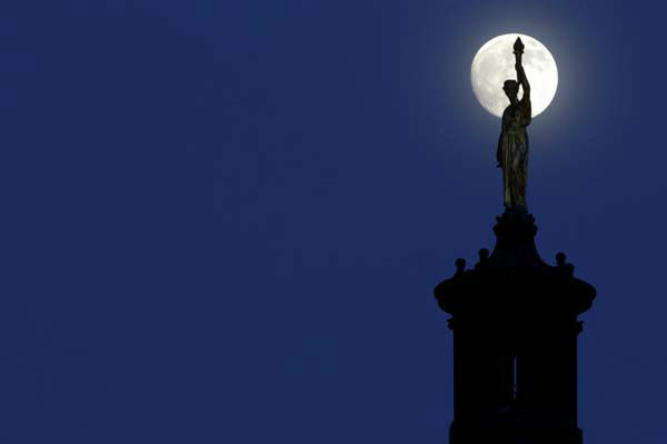 "<div class=""meta image-caption""><div class=""origin-logo origin-image ""><span></span></div><span class=""caption-text"">The moon in its waxing gibbous stage is seen behind a statue entitled ""Enlightenment Giving Power"" by John Gelert, which sits at the top of the dome of the Bergen County Courthouse in Hackensack, N.J., Friday, June 21, 2013. The moon, which will reach its full stage on Sunday, is expected to be 13.5 percent closer to earth during a phenomenon known as supermoon. (AP Photo/Julio Cortez) (AP Photo/ Julio Cortez)</span></div>"