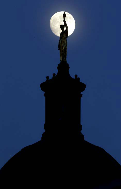 "<div class=""meta image-caption""><div class=""origin-logo origin-image ""><span></span></div><span class=""caption-text"">The moon in its waxing gibbous stage shines behind a statue entitled ""Enlightenment Giving Power"" by John Gelert, which sits at the top of the dome of the Bergen County Courthouse in Hackensack, N.J., Friday, June 21, 2013. The moon, which will reach its full stage on Sunday, is expected to be 13.5 percent closer to earth during a phenomenon known as supermoon. (AP Photo/Julio Cortez) (AP Photo/ Julio Cortez)</span></div>"
