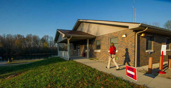A Harrison Township voter walks in to the check station at the Glendale Fish and Wildlife Area Tuesday morning Nov. 6, 2012 to vote just south of Washington, Ind.  After a grinding presidential campaign President Barack Obama and Republican presidential candidate, former Massachusetts Gov. Mitt Romney, yield center stage to American voters Tuesday for an Election Day choice that will frame the contours of government and the nation for years to come. &#40;AP Photo&#47; Daniel R. Patmore&#41; <span class=meta>(AP Photo&#47; DANIEL PATMORE)</span>