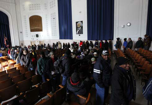 Stretching in from outside, the line of voters waiting to cast their ballots snakes through an auditorium at Far Rockaway High School on Election Day, Tuesday, Nov. 6, 2012, in the Queens borough of New York. After a grinding presidential campaign, Americans are heading into polling places across the country.  &#40;AP Photo&#47;Jason DeCrow&#41; <span class=meta>(AP Photo&#47; Jason DeCrow)</span>