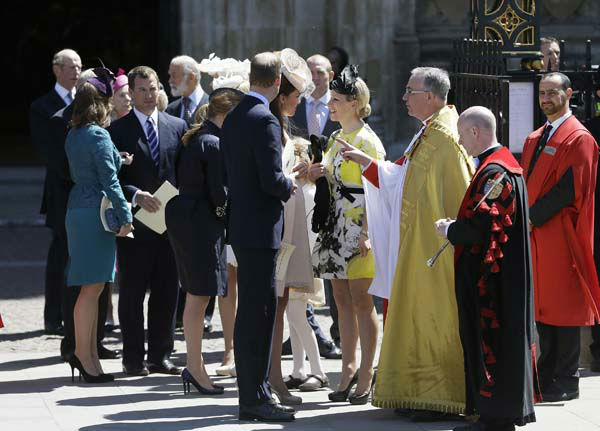 Britain&#39;s Prince William and his wife Kate Duchess of Cambridge and his cousin, Zara Phillips, talk to the Dean of Westminster Abbey Dr John Hall, third right, as they leave following a service to celebrate the 60th anniversary of the coronation of Britain&#39;s Queen Elizabeth II at Westminster Abbey, London, Tuesday, June  4, 2013. &#40;AP Photo&#47;Alastair Grant&#41; <span class=meta>(AP Photo&#47; Alastair Grant)</span>