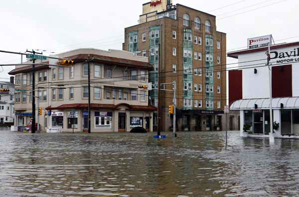 The intersection of 8th Street and Atlantic Avenue is flooded in Ocean City, N.J., Tuesday, Oct. 30, 2012, after the storm surge from Sandy flooded much of the town.  Superstorm Sandy, the storm that made landfall Monday, caused multiple fatalities, halted mass transit and cut power to more than 6 million homes and businesses.&#40;AP Photo&#47;Mel Evans&#41; <span class=meta>(AP Photo&#47; Mel Evans)</span>