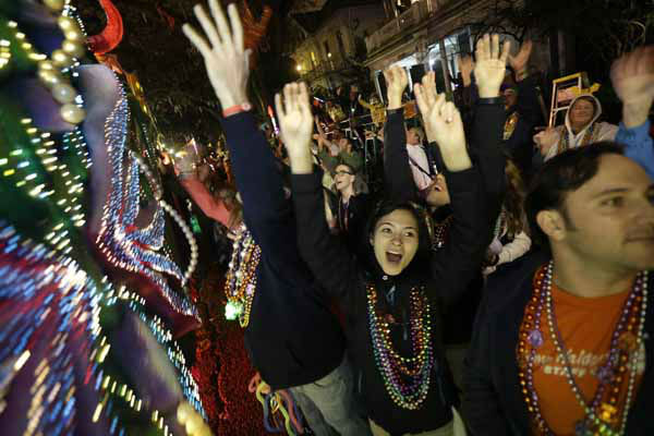 Revelers yell for beads and trinkets during the Krewe of Orpheus Mardi Gras parade in New Orleans, Monday, Feb. 11, 2013. &#40;AP Photo&#47;Gerald Herbert&#41; <span class=meta>(AP Photo&#47; Gerald Herbert)</span>