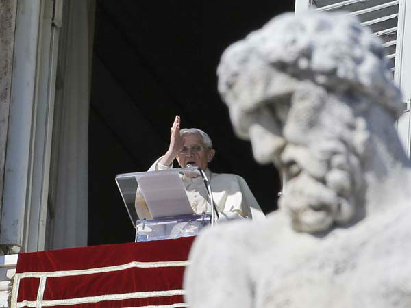 Pope Benedict XVI blesses the faithful from his studio&#39;s window overlooking St.Peter&#39;s square during the Angelus noon prayer, at the Vatican, Sunday, Feb. 10, 2013. &#40;AP Photo&#47;Gregorio Borgia&#41; <span class=meta>(AP Photo&#47; Gregorio Borgia)</span>
