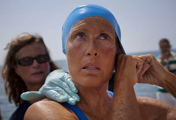 "<div class=""meta ""><span class=""caption-text "">U.S. swimmer Diana Nyad adjusts her swimming cap as a woman applies a protective ointment to her skin as she prepares to jump into the water and start her swim to Florida from Havana, Cuba, Saturday, Aug. 18, 2012. Endurance athlete Nyad launched another bid Saturday to set an open-water record by swimming from Havana to the Florida Keys without a protective shark cage.  (AP Photo/Ramon Espinosa)</span></div>"