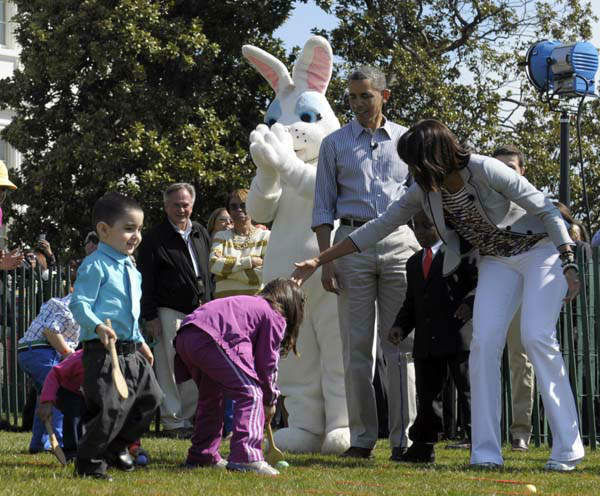 President Barack Obama and first lady Michelle Obama watch as children participate in the annual Easter Egg Roll on the South Lawn of the White House in Washington, Monday, April 1, 2013. &#40;AP Photo&#47;Susan Walsh&#41; <span class=meta>(AP Photo&#47; Susan Walsh)</span>