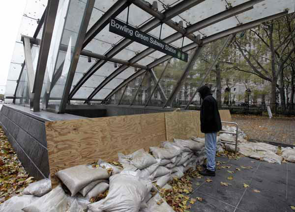 A man peers into the closed Bowling Green subway station, in New York, Tuesday, Oct. 30, 2012.  New York City awakened Tuesday to a flooded subway system, shuttered financial markets and hundreds of thousands of people without power a day after a wall of seawater and high winds slammed into the city, destroying buildings and flooding tunnels. &#40;AP Photo&#47;Richard Drew&#41; <span class=meta>(AP Photo&#47; Richard Drew)</span>