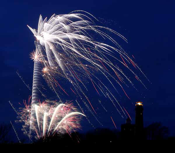 Fireworks explode next to a lighthouse at Kap Arkona on the German island of Ruegen in the Baltic Sea on New Year&#39;s Eve, Monday, Dec. 31. 2012. &#40;AP Photo&#47;dapd, Jens Koehler&#41; <span class=meta>(AP Photo&#47; Jens Koehler)</span>