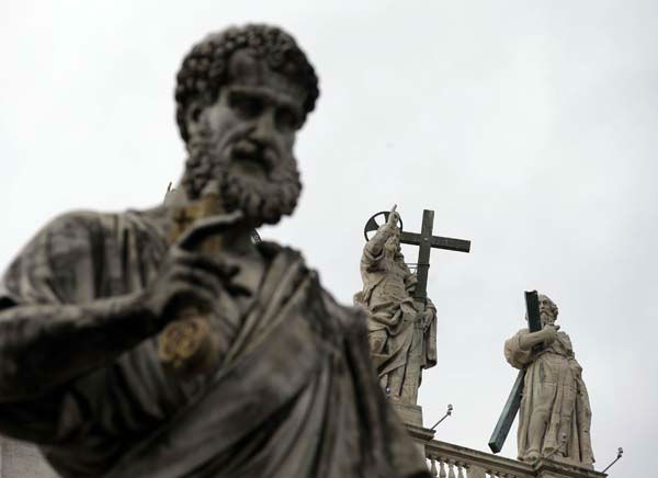 The statues of St.PeteR, left, and Jesus, center, are pictured at the Vatican, Monday, Feb. 11, 2013. Pope Benedict XVI said Monday he lacks the strength to fulfill his duties and on Feb. 28 will become the first pontiff in 600 years to resign. The announcement sets the stage for a conclave in March to elect a new leader for world&#39;s 1 billion Catholics.  &#40;AP Photo&#47;Gregorio Borgia&#41; <span class=meta>(AP Photo&#47; Gregorio Borgia)</span>