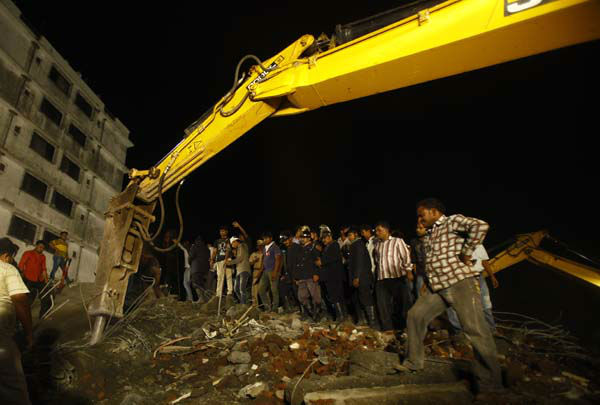 Rescue workers look for trapped people after a residential building collapsed in Thane, Mumbai, India, Thursday, April 4, 2013. At least 6 persons were killed and 40 were injured when an under construction residential building collapsed on Thursday evening according to local reports.&#40;AP Photo&#47;Rafiq Maqbool&#41; <span class=meta>(AP Photo&#47; Rafiq Maqbool)</span>