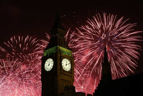 "<div class=""meta ""><span class=""caption-text "">Fireworks explode over Elizabeth Tower housing the Big Ben clock to celebrate the New Year in London, Tuesday, Jan. 1, 2013. (AP Photo/Kirsty Wigglesworth)</span></div>"