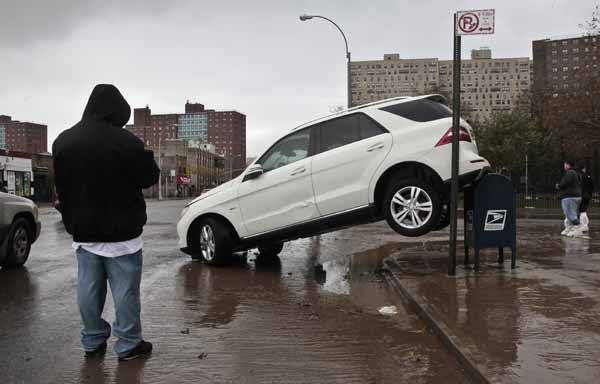 The tailend of a SUV is perched on top of a postal mailbox in the aftermath of floods from Hurricane Sandy on Tuesday, Oct. 30, 2012, in Coney Island, N.Y. Sandy, the storm that made landfall Monday, caused multiple fatalities, halted mass transit and cut power to more than 6 million homes and businesses. &#40;AP Photo&#47;Bebeto Matthews&#41; <span class=meta>(AP Photo&#47; Bebeto Matthews)</span>