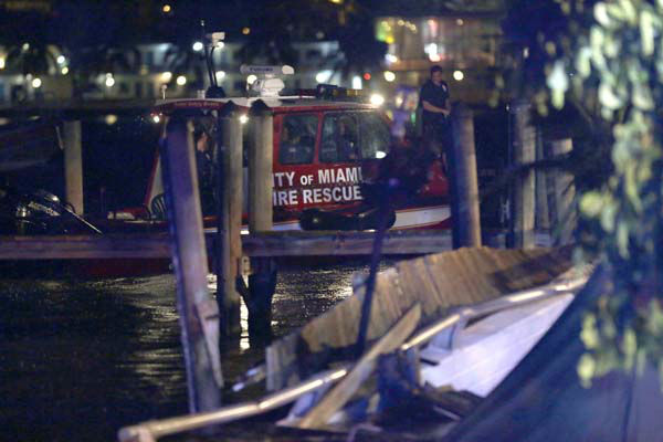 Miami-Dade fire rescue personnel  search for missing persons after a packed outdoor deck collapsed at popular Miami-area sports bar Thursday June 13, 2013. The packed outdoor deck behind the popular Miami-area sports bar partially collapsed during the NBA Finals on Thursday night, sending dozens of patrons into the shallow waters of Biscayne Bay. &#40;AP Photo&#47;Alan Diaz&#41; <span class=meta>(AP Photo&#47; Alan Diaz)</span>