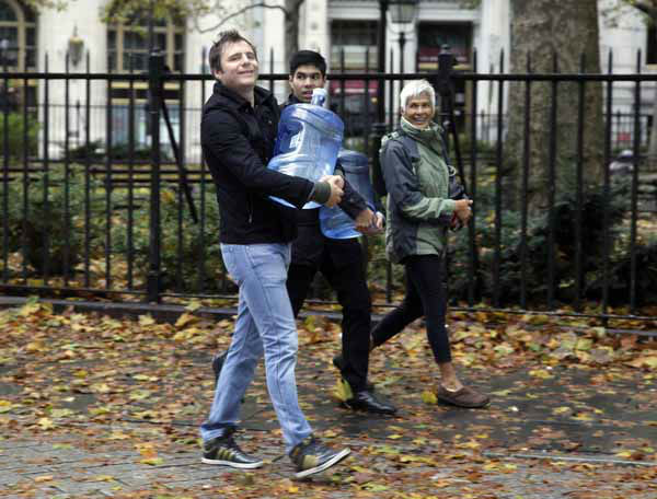 "<div class=""meta image-caption""><div class=""origin-logo origin-image ""><span></span></div><span class=""caption-text"">Three people walk home with jugs of water in lower Manhattan, in New York, Tuesday, Oct. 30, 2012. New York City awakened Tuesday to a flooded subway system, shuttered financial markets and hundreds of thousands of people without power a day after a wall of seawater and high winds slammed into the city, destroying buildings and flooding tunnels.  (AP Photo/Richard Drew) (AP Photo/ Richard Drew)</span></div>"
