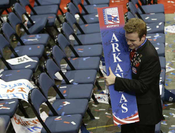 A delegate carries a state sign following Republican presidential nominee Mitt Romney&#39;s speech at the Republican National Convention in Tampa, Fla., on Thursday, Aug. 30, 2012. &#40;AP Photo&#47;Lynne Sladky&#41; <span class=meta>(AP Photo&#47; Lynne Sladky)</span>