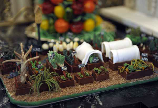 "<div class=""meta ""><span class=""caption-text "">The White House vegetable garden is replicated as part of the nearly 300-pound gingerbread house of the White House, on display in the State Dining Room of the White House in Washington, Wednesday, Nov. 28, 2012. The theme for the White House Christmas 2012 is Joy to All. The White House gingerbread house has been a tradition since the 1960s. (AP Photo/Susan Walsh) (AP Photo/ Susan Walsh)</span></div>"