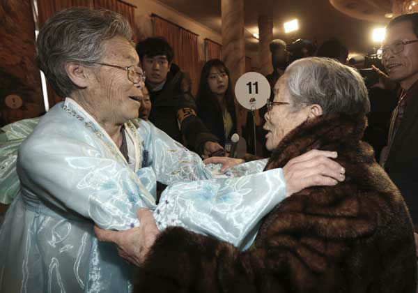 South Korean Kim Sung-yoon, 96, right, meets with her North Korean sister Kim Seok Ryu, 80, during the Separated Family Reunion Meeting at Diamond Mountain resort in North Korea, Thursday, Feb. 20, 2014. The rival nations struck a deal last week to go ahead with brief meetings of war-divided families, though there&#39;s wariness in Seoul that Pyongyang could back out again. As they waited anxiously in the days leading up to the trip, many elderly Koreans had been unsure whether they would be able to see their long-lost relatives&#39; faces before they die. &#40;AP Photo&#47;Yonhap, Lee Ji-eun&#41;  KOREA OUT <span class=meta>(Photo&#47;Lee Ji-eun)</span>