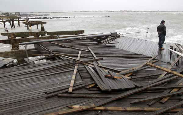 Nicholas Rodriguez looks over a section of the destroyed boardwalk in Atlantic City, N.J., Tuesday, Oct. 30, 2012, not far from where a powerful storm that started out as Hurricane Sandy made landfall the night before. Millions of people from Maine to the Carolinas awoke Tuesday without electricity, but the full extent of the damage in New Jersey, where the storm roared ashore Monday night with hurricane force, was unclear. &#40;AP Photo&#47;Seth Wenig&#41; <span class=meta>(AP Photo&#47; Seth Wenig)</span>