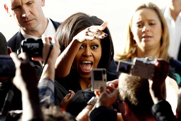 First lady Michelle Obama reaches to shake hands with supporters following a rally in a hangar at the Charlotte Douglas International Airport in Charlotte, N.C. Monday Nov. 5, 2012.  <span class=meta>(AP Photo&#47;Bob Leverone)</span>