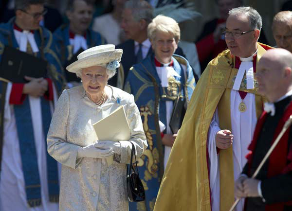 "<div class=""meta ""><span class=""caption-text "">Britain's Queen Elizabeth II escorted by the Dean of  Westminster Abbey, Dr John Hall, leave after a service to celebrate the 60th anniversary of the coronation of the Queen at Westminster Abbey, London, Tuesday, June  4, 2013. (AP Photo/Alastair Grant) (AP Photo/ Alastair Grant)</span></div>"