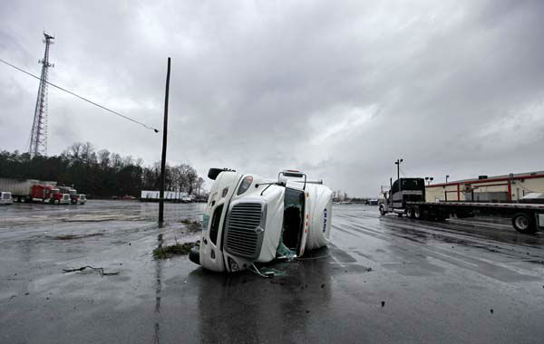 An overturned tractor trailer sits in a parking lot following a tornado, Wednesday, Jan. 30, 2013, in Adairsville, Ga. A fierce storm system that roared across Georgia has left at least one person dead after it demolished buildings and flipped vehicles on Interstate 75 northwest of Atlanta. &#40;AP Photo&#47;David Goldman&#41; <span class=meta>(AP Photo&#47; David Goldman)</span>