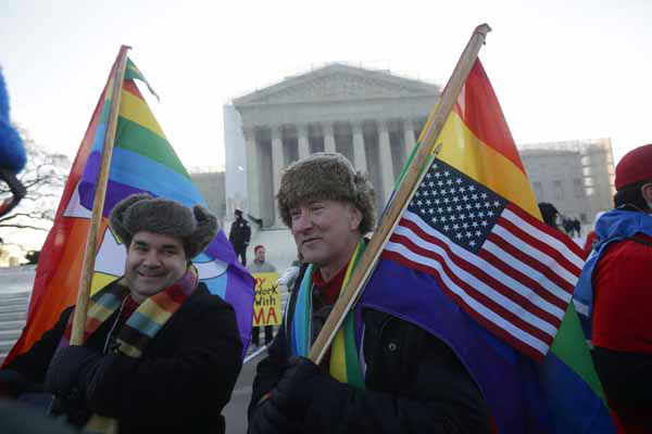 Marcus, left, and Daniel  German-Dominguez stand outside the Supreme Court in Washington, Tuesday, March 26, 2013, before the court&#39;s hearing on California?s voter approved ban on same-sex marriage. &#40;AP Photo&#47;Pablo Martinez Monsivais&#41; <span class=meta>(Photo&#47;Pablo Martinez Monsivais)</span>