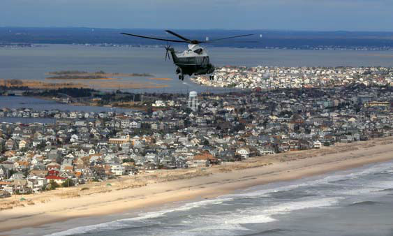 Marine One, carrying President Barack Obama and New Jersey Gov. Chris Christie, take an aerial tour of the Atlantic Coast in New Jersey in areas damaged by superstorm Sandy, Wednesday, Oct. 31, 2012.  <span class=meta>(AP Photo&#47;Doug Mills, Pool)</span>