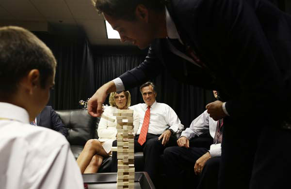 "<div class=""meta ""><span class=""caption-text "">Republican presidential candidate former Massachusetts Gov. Mitt Romney is seated with his wife Ann Romney as his son Craig and grandson Nick as they play a game of Jenga in the family holding room before the start of the first presidential debate in Denver, Wednesday, Oct. 3, 2012. (AP Photo/Charles Dharapak) (AP Photo/ Charles Dharapak)</span></div>"