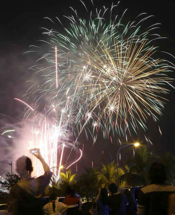 "<div class=""meta ""><span class=""caption-text "">Fireworks light up the sky to welcome in the New Year, Tuesday Jan. 1, 2013 at the scenic Manila Bay in Manila, Philippines. The Philippine government has been vigorously campaigning against the use of firecrackers which often result to injuries and deaths. (AP Photo/Bullit Marquez) (AP Photo/ Bullit Marquez)</span></div>"