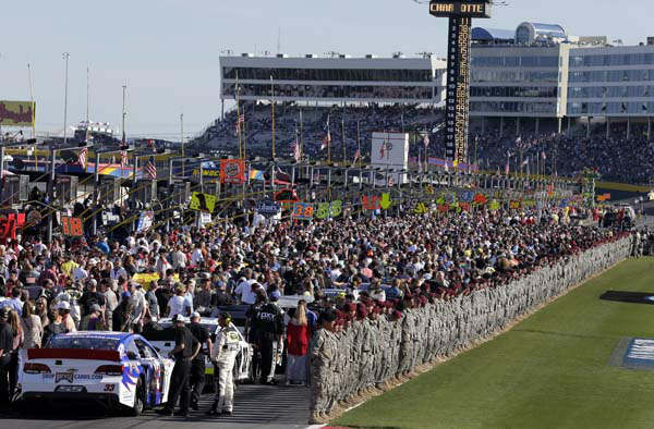 Soldiers line up along pit road before the start of the NASCAR Sprint Cup series Coca-Cola 600 auto race at Charlotte Motor Speedway in Concord, N.C., Sunday, May 26, 2013. &#40;AP Photo&#47;Chuck Burton&#41; <span class=meta>(AP Photo&#47; Chuck Burton)</span>