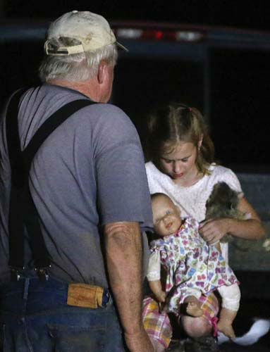 "<div class=""meta ""><span class=""caption-text "">Seven-year-old Katrina Ash, right, holds a doll as she waits with her grandfather, Michael Bowen, left, after a tornado ripped through their neighborhood near Dale, Okla., Sunday, May 19, 2013. Residents are not being allowed back into the neighborhood as search and rescue efforts take place. (AP Photo Sue Ogrocki) (AP Photo/ Sue Ogrocki)</span></div>"