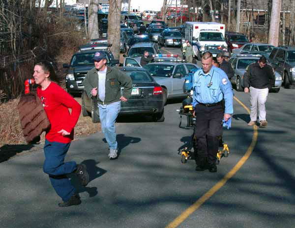 In this photo provided by the Newtown Bee, paramedics and others rush toward Sandy Hook Elementary School in Newtown, Conn., where authorities say a gunman opened fire, killing 26 people, including 20 children, Friday, Dec. 14, 2012. &#40;AP Photo&#47;Newtown Bee, Shannon Hicks&#41; MANDATORY CREDIT: NEWTOWN BEE, SHANNON HICKS <span class=meta>(AP Photo&#47; Shannon Hicks)</span>