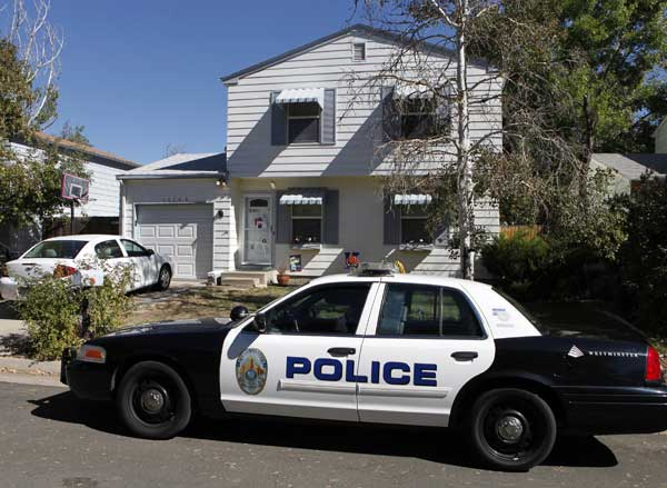 A Westminster police officer sits in her partrol car at the home of ten-year-old Jessica Ridgeway in Westminster, Colo., on Monday, Oct. 8, 2012. The youngster has been missing since she left her home Friday morning on her way to school.  <span class=meta>(AP Photo&#47;Ed Andrieski)</span>